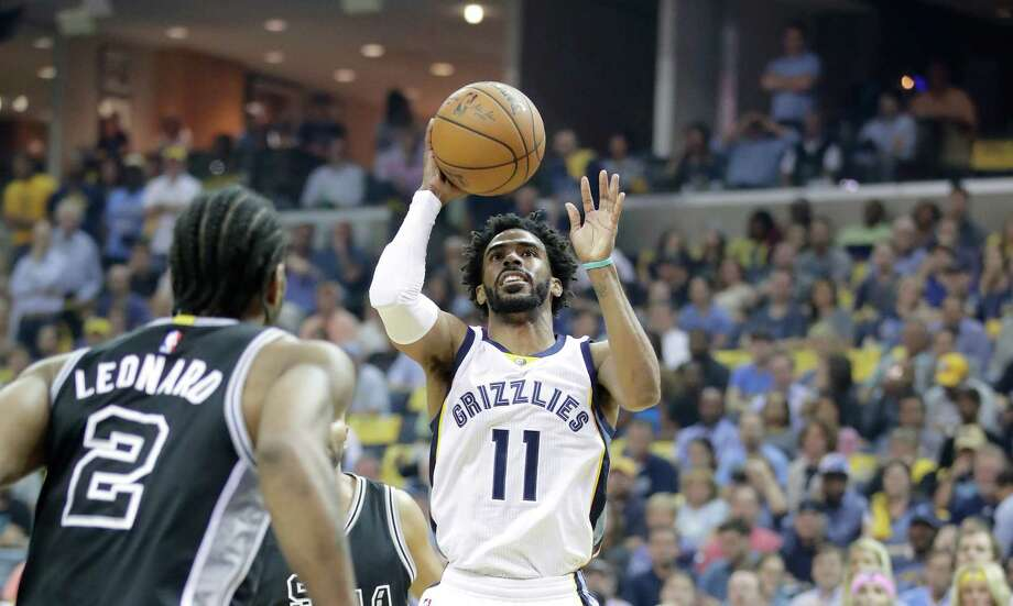 MEMPHIS, TN - APRIL 20:  Mike Conley #11 of the Memphis Grizzlies shoots the ball against the  San Antonio Spurs in game three of the Western Conference Quarterfinals during the 2017 NBA Playoffs at FedExForum on April 20, 2017 in Memphis, Tennessee.   NOTE TO USER: User expressly acknowledges and agrees that, by downloading and or using this photograph, User is consenting to the terms and conditions of the Getty Images License Agreement Photo: Andy Lyons, Getty Images / 2017 Getty Images
