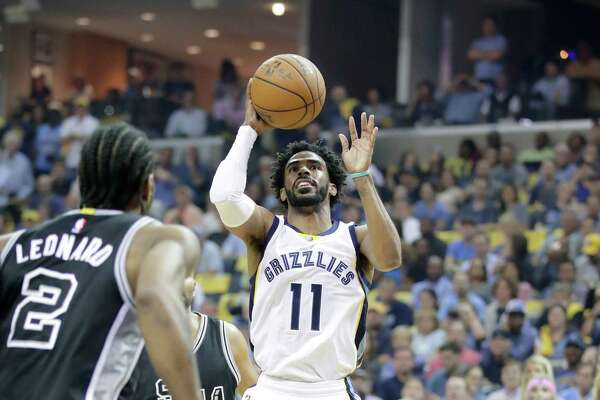 MEMPHIS, TN - APRIL 20:  Mike Conley #11 of the Memphis Grizzlies shoots the ball against the  San Antonio Spurs in game three of the Western Conference Quarterfinals during the 2017 NBA Playoffs at FedExForum on April 20, 2017 in Memphis, Tennessee.   NOTE TO USER: User expressly acknowledges and agrees that, by downloading and or using this photograph, User is consenting to the terms and conditions of the Getty Images License Agreement