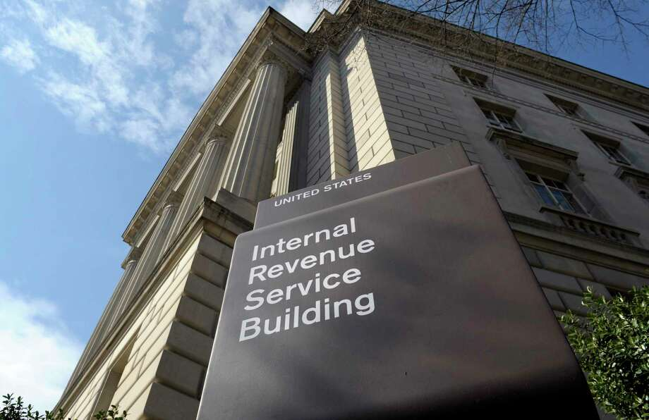 Private debt collectors hired by the IRS will be working on commission, receiving up to 25 percent of the delinquent debt they collect. Photo: Susan Walsh, STF / Copyright 2016 The Associated Press. All rights reserved.