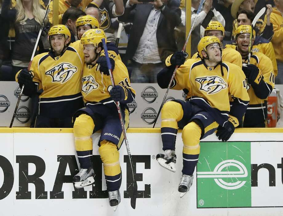 Nashville Predators players jump onto the ice to celebrate after defeating the Chicago Blackhawks 4-1  in Game 4 of a first-round NHL hockey playoff series Thursday, April 20, 2017, in Nashville, Tenn. The Predators swept the series. (AP Photo/Mark Humphrey) Photo: Mark Humphrey, Associated Press