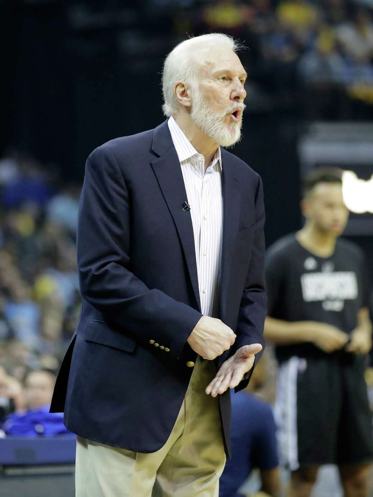 MEMPHIS, TN - APRIL 20: Greg Popovich the head coach of the San Antonio Spurs gives instructions to his team against the Memphis Grizzlies in game three of the Western Conference Quarterfinals during the 2017 NBA Playoffs at FedExForum on April 20, 2017 in Memphis, Tennessee. NOTE TO USER: User expressly acknowledges and agrees that, by downloading and or using this photograph, User is consenting to the terms and conditions of the Getty Images License Agreement