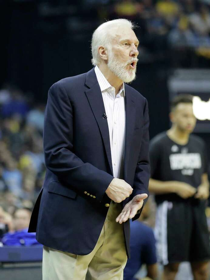 MEMPHIS, TN - APRIL 20:  Greg Popovich the head coach of the San Antonio Spurs gives instructions to his team against the Memphis Grizzlies in game three of the Western Conference Quarterfinals during the 2017 NBA Playoffs at FedExForum on April 20, 2017 in Memphis, Tennessee.   NOTE TO USER: User expressly acknowledges and agrees that, by downloading and or using this photograph, User is consenting to the terms and conditions of the Getty Images License Agreement Photo: Andy Lyons, Getty Images / 2017 Getty Images