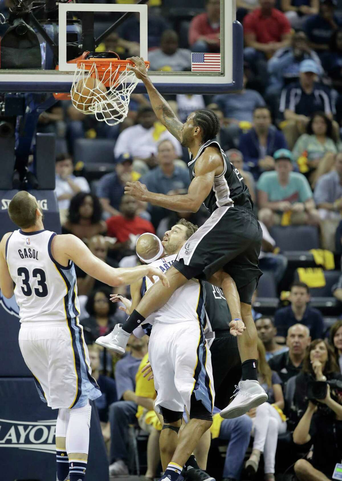 MEMPHIS, TN - APRIL 20: Kawhi Leonard #2 of the San Antonio Spurs dunks the ball against the Memphis Grizzlies in game three of the Western Conference Quarterfinals during the 2017 NBA Playoffs at FedExForum on April 20, 2017 in Memphis, Tennessee. NOTE TO USER: User expressly acknowledges and agrees that, by downloading and or using this photograph, User is consenting to the terms and conditions of the Getty Images License Agreement