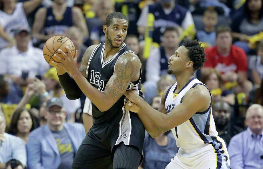MEMPHIS, TN - APRIL 20:  LaMarcus Aldridge #12 of the San Antonio Spurs looks to shoot the ball while defended by Wayne Selden Jr.#7 of the Memphis Grizzlies in game three of the Western Conference Quarterfinals during the 2017 NBA Playoffs at FedExForum on April 20, 2017 in Memphis, Tennessee.   NOTE TO USER: User expressly acknowledges and agrees that, by downloading and or using this photograph, User is consenting to the terms and conditions of the Getty Images License Agreement Photo: Andy Lyons, Getty Images / 2017 Getty Images