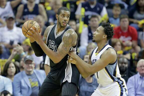 MEMPHIS, TN - APRIL 20:  LaMarcus Aldridge #12 of the San Antonio Spurs looks to shoot the ball while defended by Wayne Selden Jr.#7 of the Memphis Grizzlies in game three of the Western Conference Quarterfinals during the 2017 NBA Playoffs at FedExForum on April 20, 2017 in Memphis, Tennessee.   NOTE TO USER: User expressly acknowledges and agrees that, by downloading and or using this photograph, User is consenting to the terms and conditions of the Getty Images License Agreement