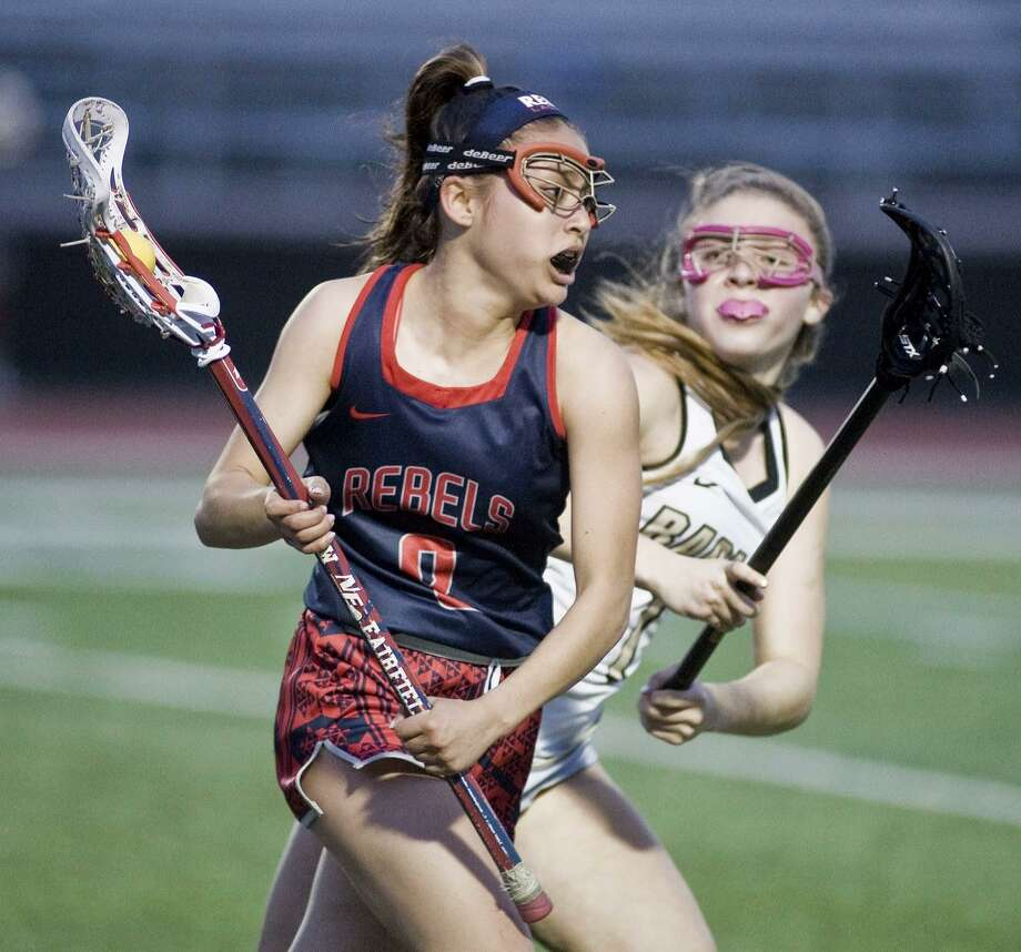 New Fairfield High School's Shania Latassa tries to get around Joel Barlow High School's Julia Shapiro in a game played at Barlow. Thursday, April 20, 2017 Photo: Scott Mullin / For Hearst Connecticut Media / The News-Times Freelance