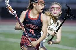 New Fairfield High School's Shania Latassa tries to get around Joel Barlow High School's Julia Shapiro in a game played at Barlow. Thursday, April 20, 2017