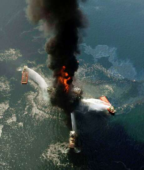 The Deepwater Horizon burns on April 21, 2010, in the Gulf of Mexico. A new study is an attempt to put a value on the environmental losses from the disaster. Photo: Gerald Herbert, STF / AP
