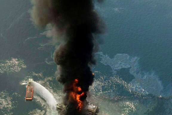 The Deepwater Horizon burns on April 21, 2010, in the Gulf of Mexico. A new study is an attempt to put a value on the environmental losses from the disaster.