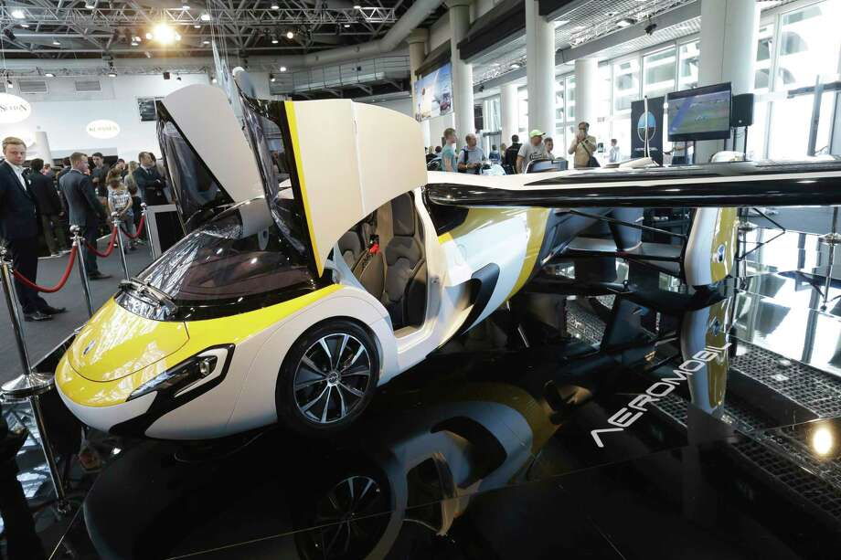The AeroMobil has a driving range of about 60 miles and a top speed of nearly 100 mph. When flying, its maximum cruising range is 466 miles. It takes about three minutes for the car to transform into a plane. Photo: Claude Paris, STR / Copyright 2017 The Associated Press. All rights reserved.