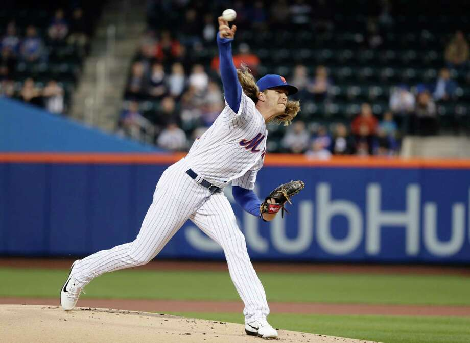 New York Mets' Noah Syndergaard delivers a pitch during the first inning of the team's baseball game against the Philadelphia Phillies on Thursday, April 20, 2017, in New York. (AP Photo/Frank Franklin II) ORG XMIT: NYM104 Photo: Frank Franklin II / Copyright 2017 The Associated Press. All rights reserved.