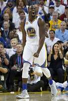 OAKLAND, CA - OCTOBER 25:  Draymond Green #23 of the Golden State Warriors reacts after making a three-point shot against the San Antonio Spurs during the third quarter in an NBA basketball game at ORACLE Arena on October 25, 2016 Oakland, California. NOTE TO USER: User expressly acknowledges and agrees that, by downloading and or using this photograph, User is consenting to the terms and conditions of the Getty Images License Agreement.  (Photo by Thearon W. Henderson/Getty Images)