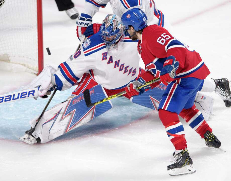 New York Rangers goalie Henrik Lundqvist (30) makes the save on Montreal Canadiens centre Andrew Shaw (65) during the first period of Game 5 of a first-round NHL hockey Stanley Cup playoff series, Thursday, April 20, 2017, in Montreal. (Ryan Remiorz/The Canadian Press via AP) ORG XMIT: RYR105 Photo: Ryan Remiorz / The Canadian Press