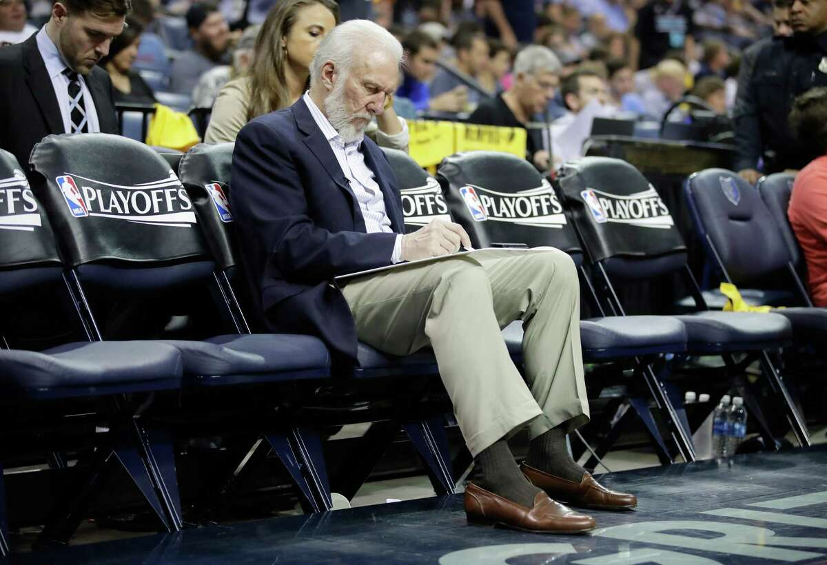 Spurs coach Gregg Popovich draws up a play while on the bench against the Grizzlies during Game 3 at FedExForum on April 20, 2017 in Memphis, Tenn.