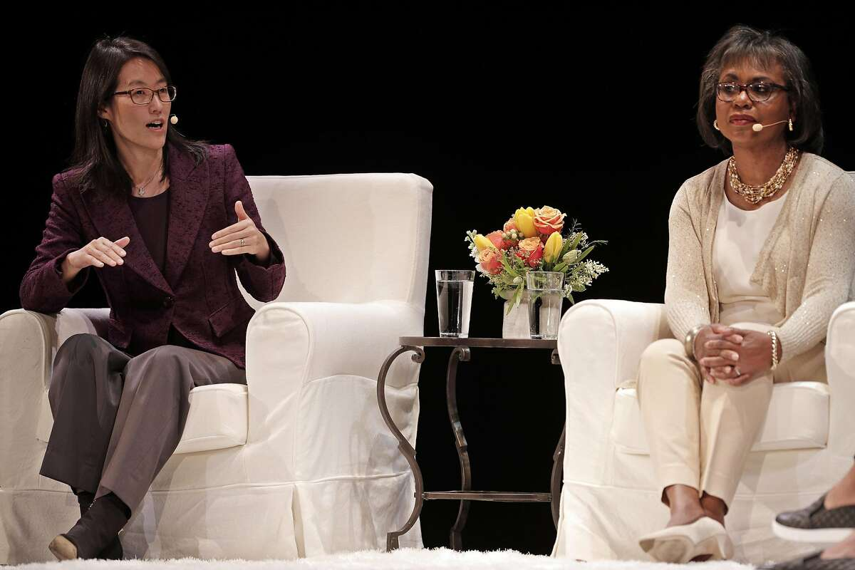 Ellen Pao, left, answers a question as Anita Hill listens on stage during a conversation about sexual harassment, workplace discrimination and other issues facing women in the workplace at the Nourse Theater in San Francisco, Calif., on Thursday, April 20, 2017. The event was hosted by the Kapor Center for Social Impact.