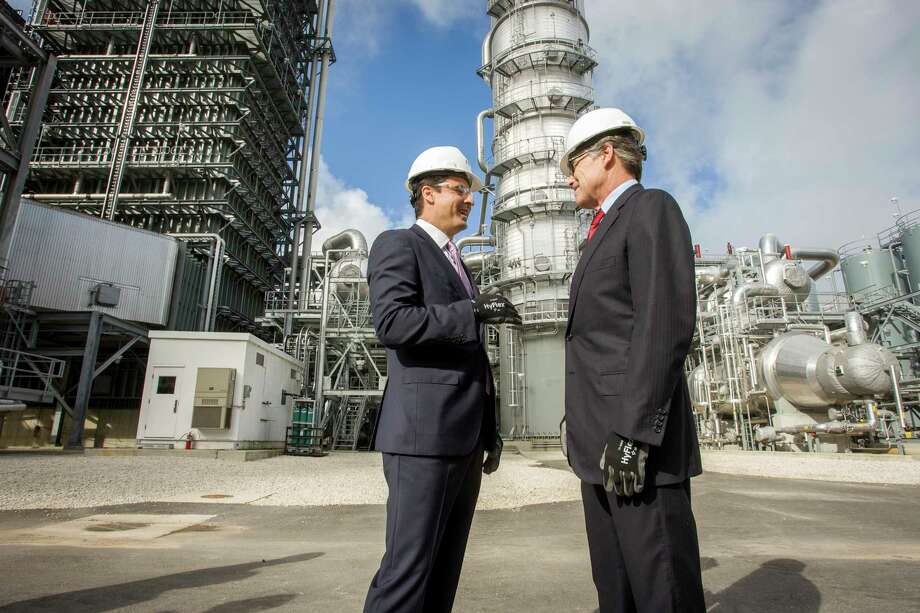 U.S. Secretary of Energy Rick Perry (right) joins NRG Energy CEO Mauricio Gutierrez (left) on a tour of the Petra Nova carbon capture and enhanced oil recovery system on Thursday, April 13, 2017, in Fort Bend County.  Continue to see earnings reports from other energy companies.  Photo: Paul Ladd, FRE / FR170385 AP