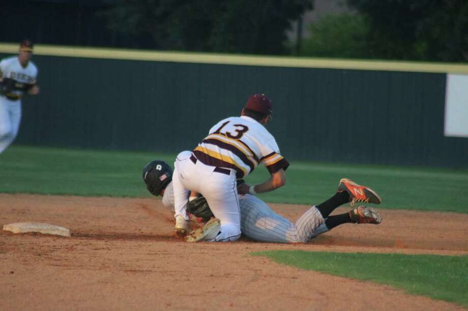 Following a terrific throw by catcher Reese Moon, Deer Park shortstop Josiah Ortiz applies the tag on an attempted basestealer during third inning action Thursday night. Photo: Robert Avery