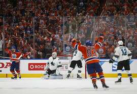 San Jose Sharks goalie Martin Jones (31) watches as the Edmonton Oilers celebrate their tying goal during the third period of Game 5 of a first-round NHL hockey Stanley Cup playoff series, Thursday, April 20, 2017, in Edmonton, Alberta. (Jeff McIntosh/The Canadian Press via AP)