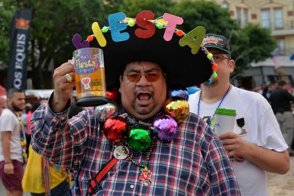 Fiesta-goers celebrate the pack HemisfairPark on April 20 for Fiesta Fiesta, the event that signals the beginning of Fiesta 2017. Fiesta Fiesta featured dozens of medals at Pin Pandemonium, live music and more.