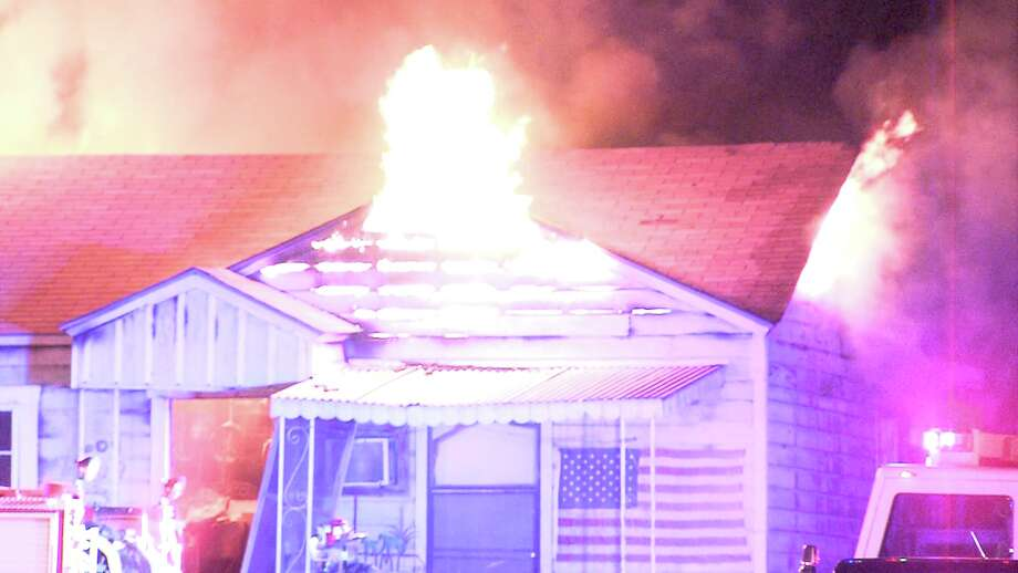Firefighters went to extinguish the blaze around 1:45 a.m. on April 21, 2017, at a home in the 600 block of Linares Street. When they arrived, flames were shooting out of the home's attic. Photo: Ken Branca