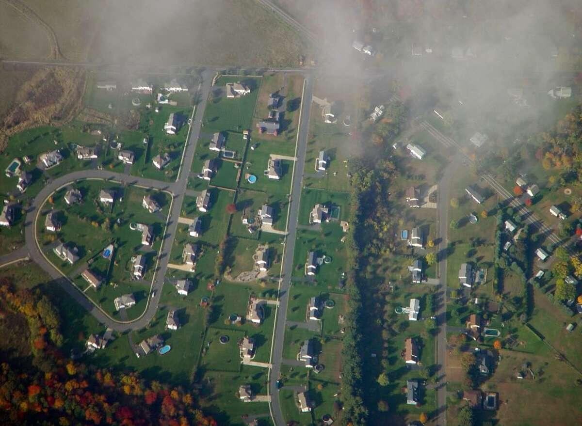 Suburban sprawl, such as this development in upstate Connecticut, are causing a significant decline in the state's forests, according to the Wildlands and Woodlands report released in May by Yale and Harvard universities.