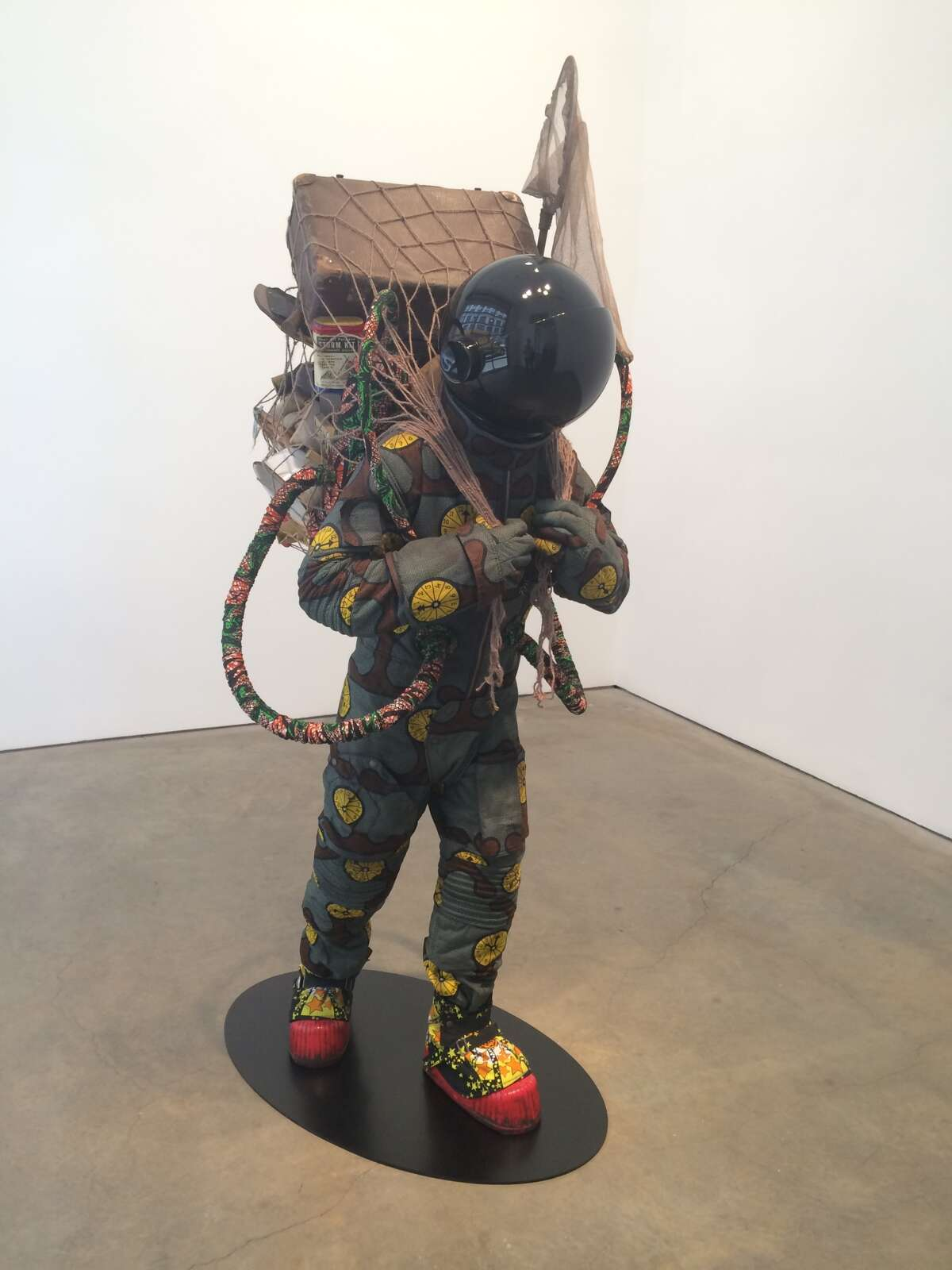 """""""Refugee Astronaut"""" by Yinka Shonibare, MBE, on view in May 2015 at the James Cohan Gallery in New York City. The sculpture served as inspiration for Michael Janairo's poem """"For Your Own Safety,"""" which was nominated by Star*Line magazine for a Pushcart Prize. (Photograph by Michael Janairo)"""