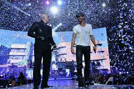 Enrique Iglesias and Pitbull with special guest J Balvin perform at opening night of U.S. tour at Prudential Center on September 12, 2014 in Newark, New Jersey.