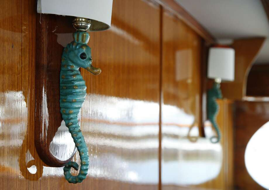 Seahorse light fixtures are seen aboard the 60-foot yacht Miss 102 at the St. Francis Yacht Club in San Francisco. Photo: Paul Chinn, The Chronicle