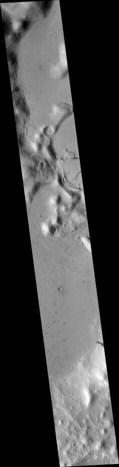 Image piece from a photo taken by the HiRISE camera on board the Mars Reconnaissance Orbiter take in March 2003. CLICK through as we zoom in and piece the two together.  Photo: NASA