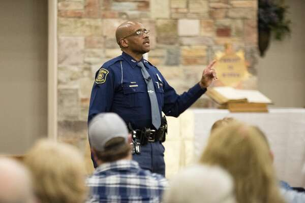 "DANIELLE McGREW TENBUSCH | for the Daily News Michigan State Police trooper Mike White tells attendees about human trafficking, particularly sex trafficking, during a Human Trafficking Seminar at Faith United Methodist Church in Coleman on Wednesday.  ""It's not just in cities,"" he said. ""Human trafficking is a form of modern-day slavery."""