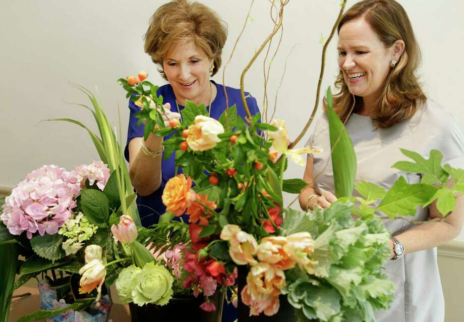 Carole Bailey, left, and Sara Ledbetter demonstrate some of the floral-design techniques that will be on display during the Florescence competition. Photo: Melissa Phillip, Staff / © 2017 Houston Chronicle