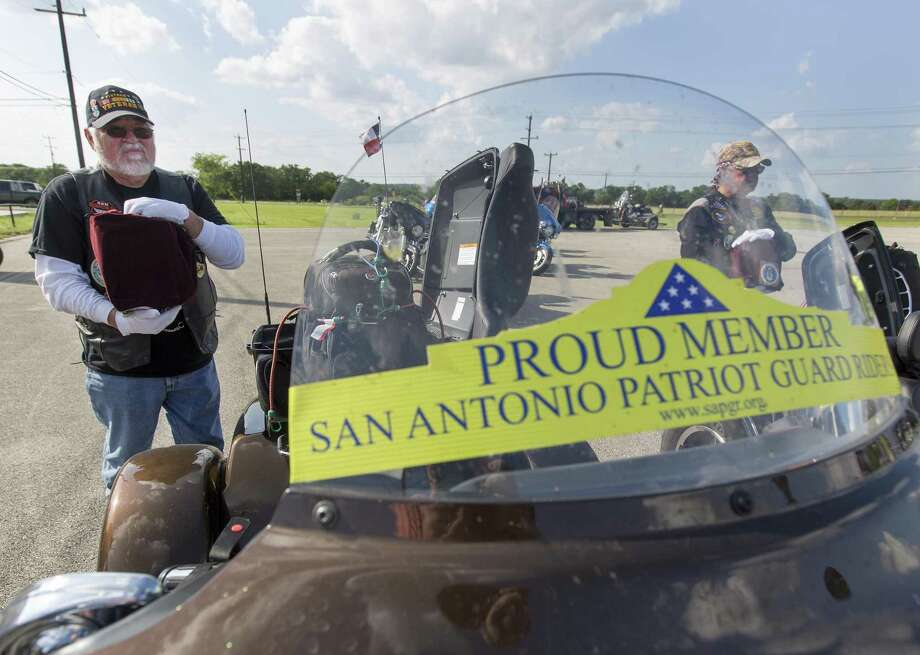 Vietnam veteran and Patriot Guard Riders member Joe Rios holds an urn Thursday, April 20, 2017 containing the ashes of a veteran who had been interred in the basement of the Abilene courthouse as the ashes arrived in the San Antonio area prior to being buried at Ft. Sam Houston National Cemetery Friday. Photo: William Luther, Staff / San Antonio Express-News / © 2017 San Antonio Express-News