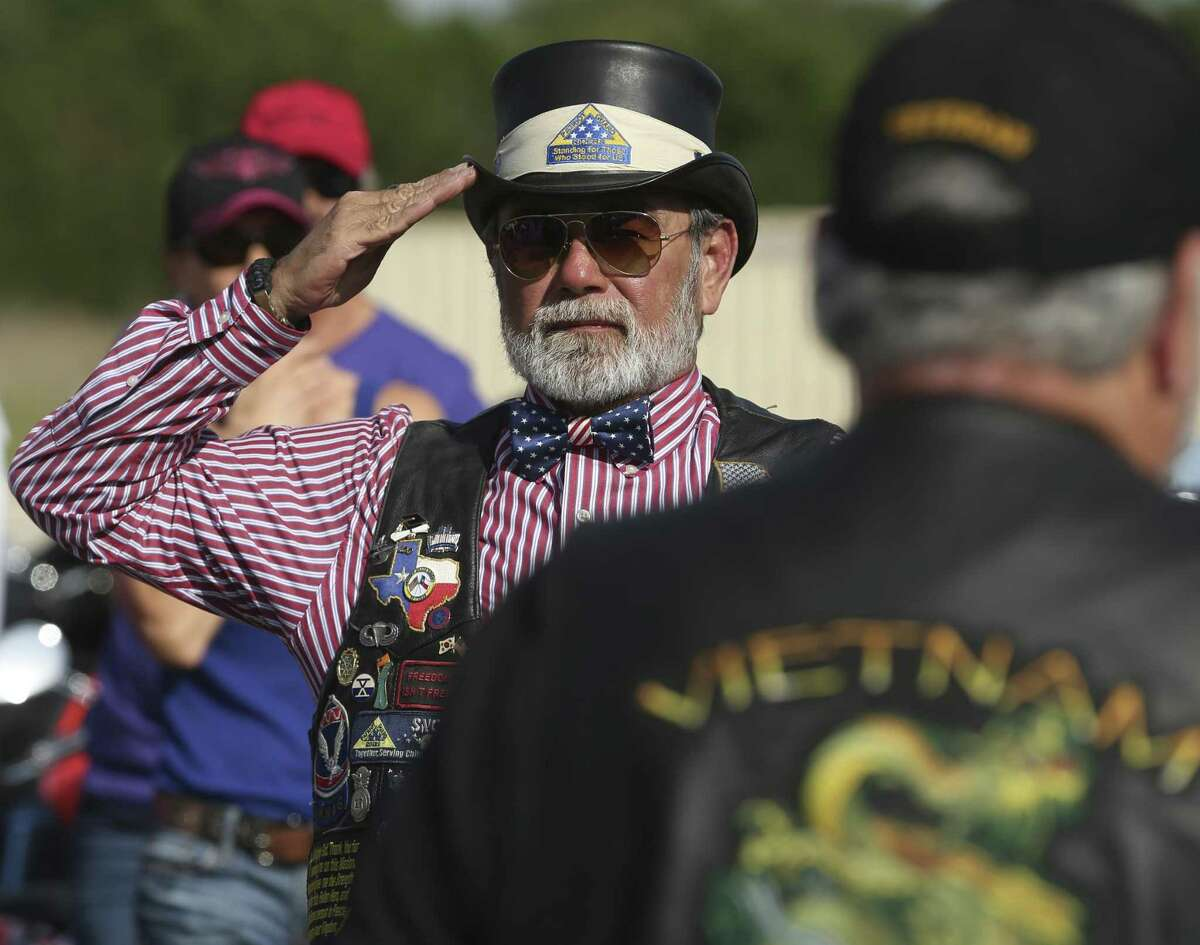 Jean Clark salutes during a ceremony as the remains of several veterans arrive in San Antonio Thursday, April 20, 2017 after members of the Patriot Guard Riders brought the ashes from Abeline where they had been interred in the city's courthouse basement.