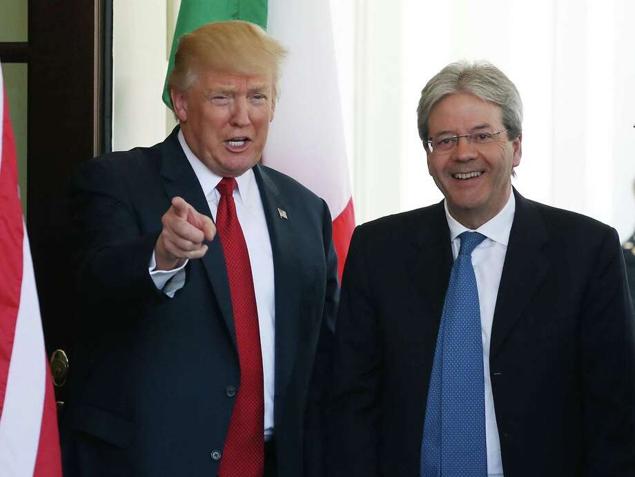 President Donald Trump welcomes Italian Prime Minister Paolo Gentiloni after he arrives at the White House. Photo: Mark Wilson /Getty Images / 2017 Getty Images