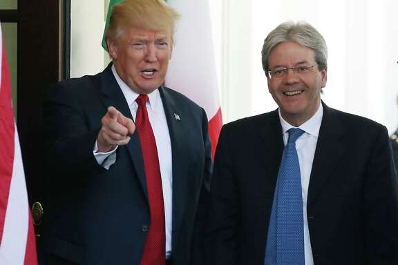 President Donald Trump welcomes Italian Prime Minister Paolo Gentiloni after he arrives at the White House.