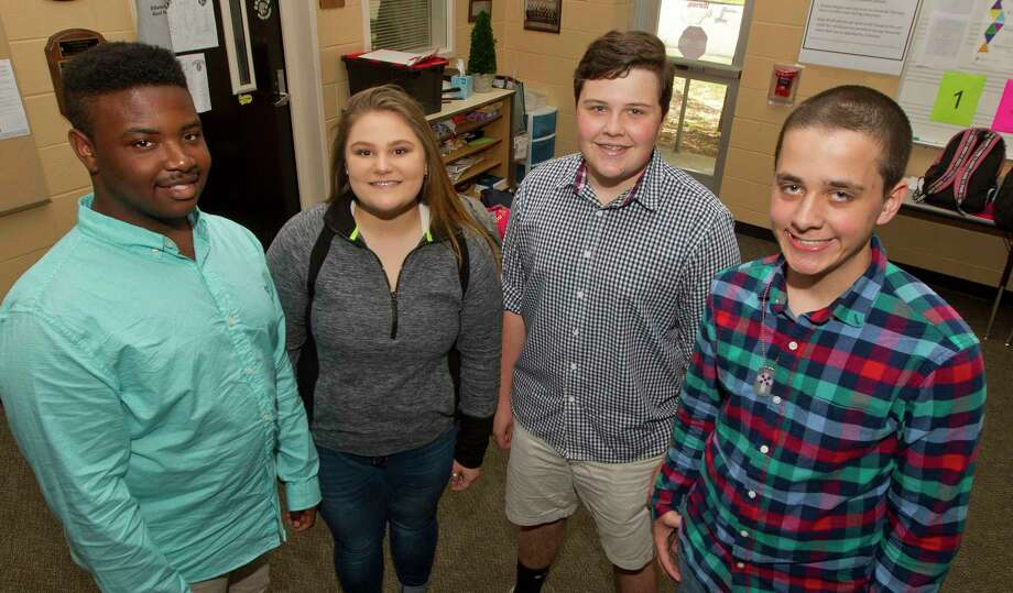 Conroe's Jaydon Archie, Kayla Swan, Kyler West and Brandon Veazey were four of the 24 choir students from Conroe ISD recognized by the district's Board of Trustees for being named to this year's Texas Music Educators Association's all-state choir. Photo: Jason Fochtman, Staff Photographer / © 2017 Houston Chronicle