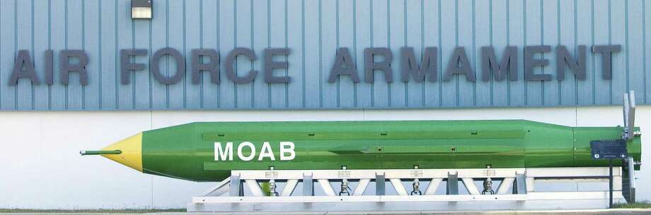 """A GBU-43B, or Massive Ordnance Air Blast bomb — also known as """"the mother of all bombs"""" — is shown at the Air Force Armament Museum on Eglin AFB. Does it represent America's defense plan — merely responding to security threats? Or will the U.S. also try to shape the environments in which threats emerge? Photo: Associate Press File Photo / Northwest Florida Daily News"""