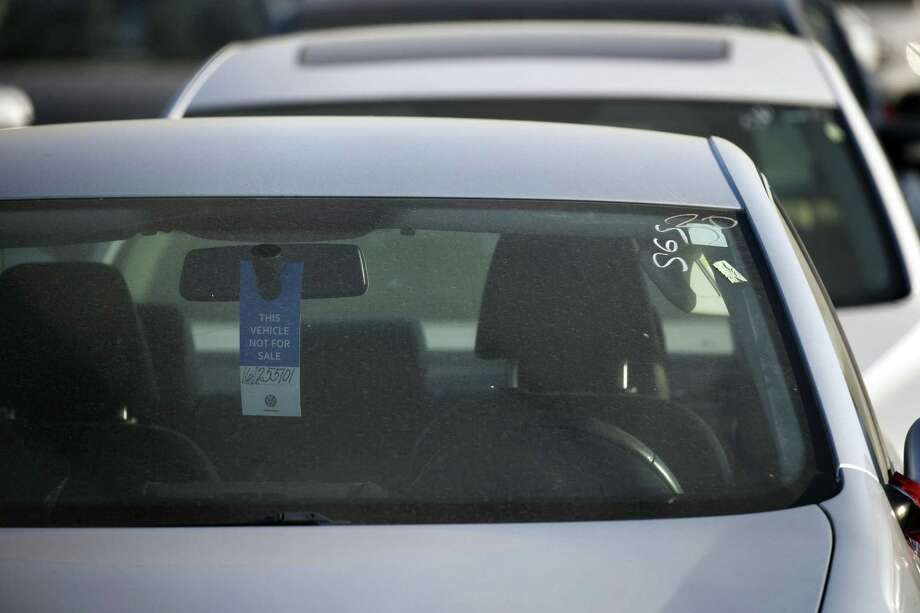 "A tag hanging inside a Volkswagen vehicle parked in a California storage lot reads ""This Vehicle Not For Sale."" The automaker is storing diesel vehicles that had been rigged to pass U.S. emissions tests. On Friday, U.S. District Judge Sean Cox ordered Volkswagen to pay a $2.8 billion criminal penalty in the United States for cheating on diesel emissions tests, blessing a deal negotiated by the government for a ""massive fraud"" orchestrated by the German automaker. Photo: Patrick T. Fallon /Bloomberg News / © 2017 Bloomberg Finance LP"