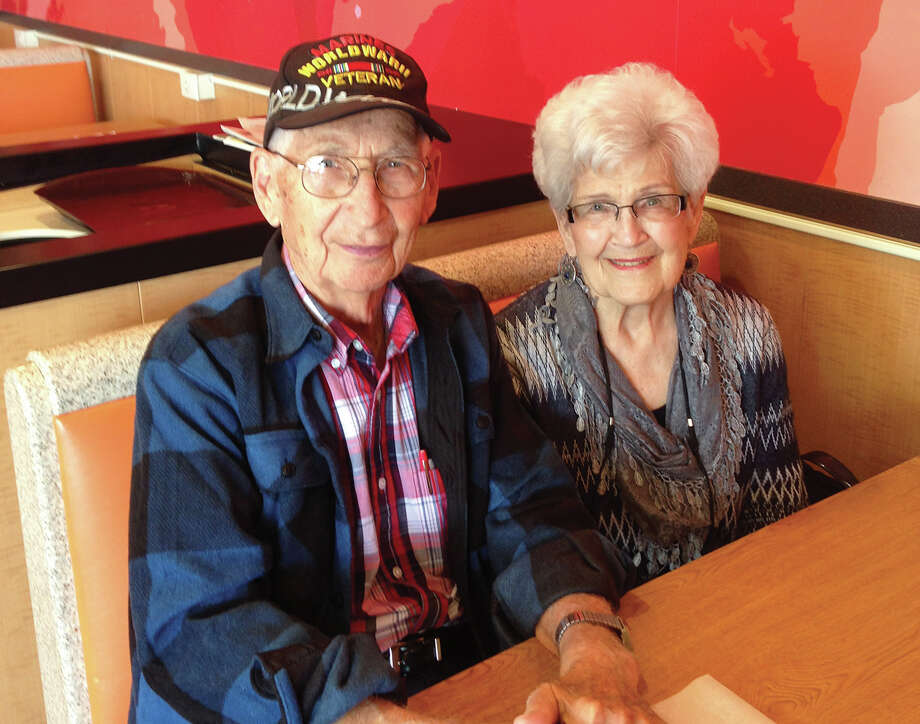 Thom Kolesa, left, and Norma Deist got together recently at McDonald's for an impromptu 75th class reunion. Both graduated from Edwardsville High School in 1942. Photo: For The Intelligencer