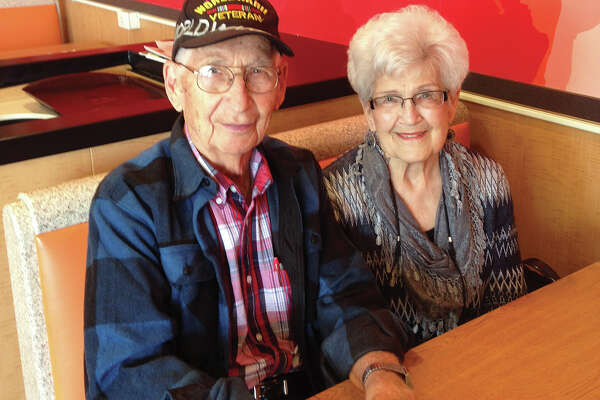 Thom Kolesa, left, and Norma Deist got together recently at McDonald's for an impromptu 75th class reunion. Both graduated from Edwardsville High School in 1942.