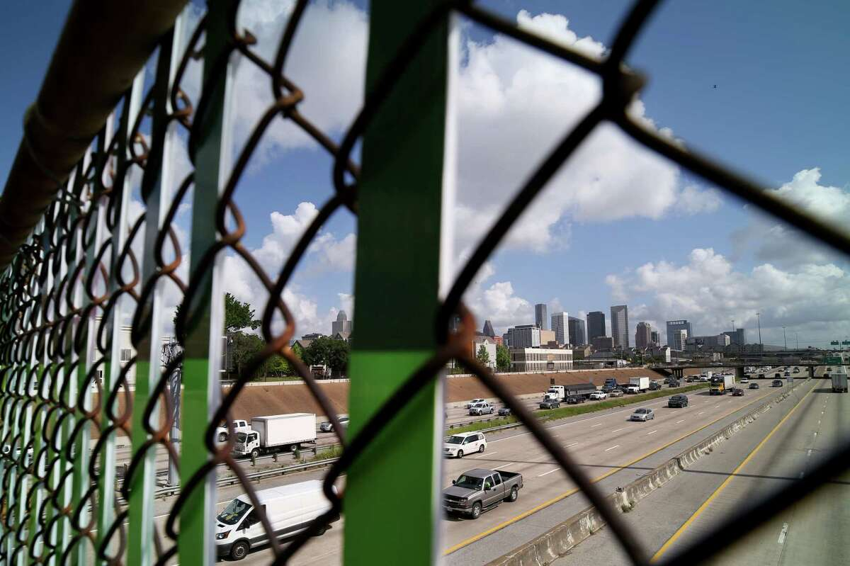 One-inch-wide strips of Coroplast have been threaded through the chain-link fence, installed during the '50s, forming colorful murals that seem to float above the freeway.