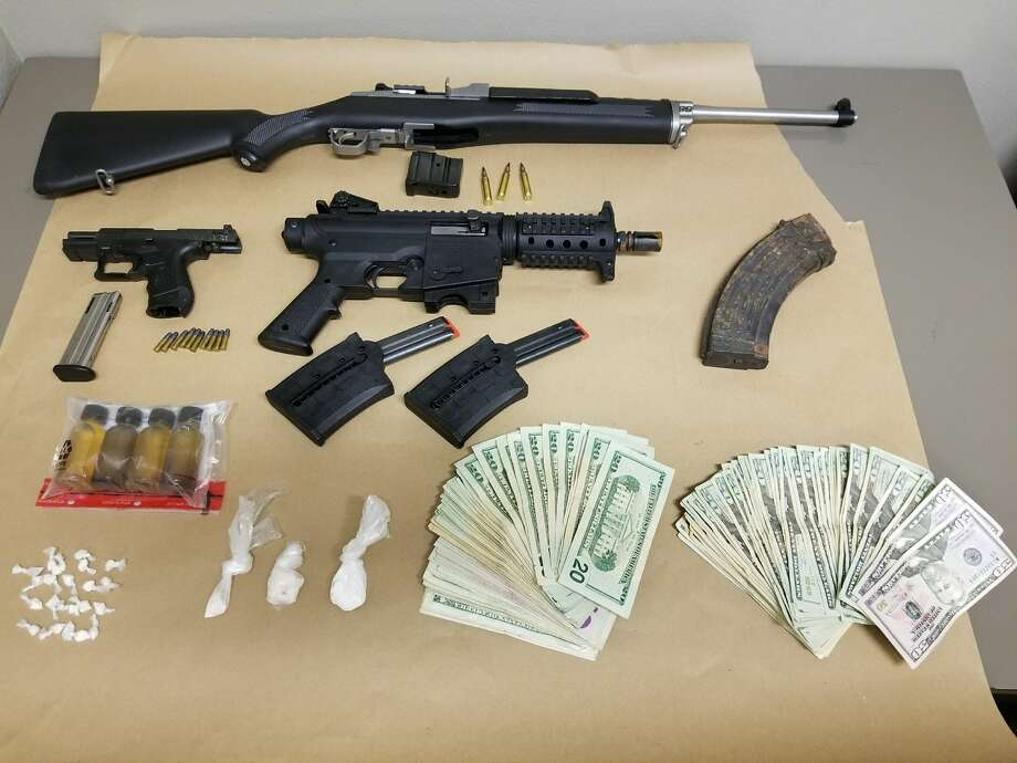 Schenectady police seized drugs, weapons and cash in a raid on Thursday, April 20, 2017, on a Germania Avenue home. Two men were arrested. (Schenectady police photo) Photo: Schenectady Police