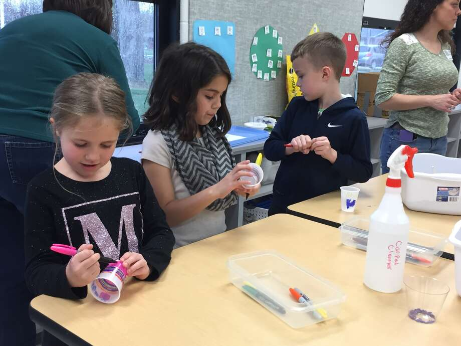 Midway Elementary students working on Fine Arts Day projects are, from left: Madalyn Callovini, Claire Villalobos and Jackson Ruf. Photo: Julia Biggs • Intelligencer