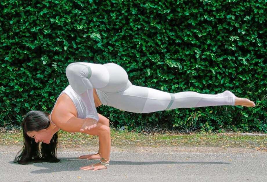 NAME: Michelle ManeeveseGYM/STUDIO: Revolution Studio, 28OO Kirby; O Athletik, 767 N Shepherd Dr, SPECIALTY: Yoga Photo: Dean Digamon