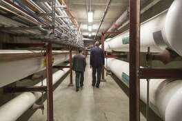 """Stamford Hospital's LEED Project Director Stanley Hunter and Executive Director of Facilities Michael Smeriglio walk through a tunnel in the hospital that carries utilities throughout the building on Tuesday, April 18, 2017. The new building has """"green"""" features that promote environmental sustainability."""