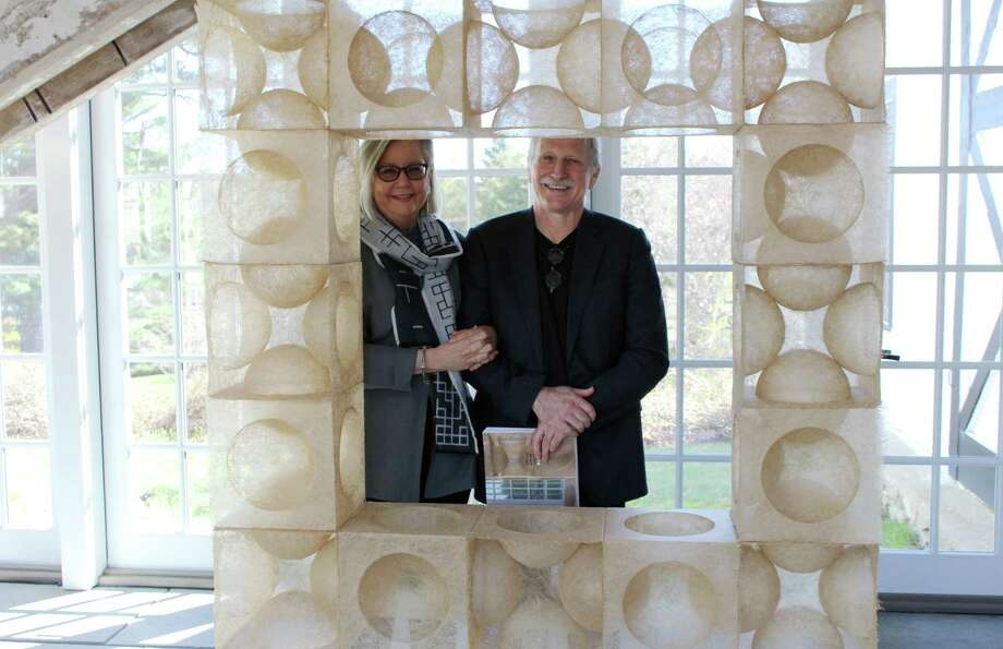 Wilton couple Rhonda Brown and Tom Grotta behind one of the featured art inside their home gallery at 276 Ridgefield Road. Photo: Stephanie Kim / Hearst Connecticut Media