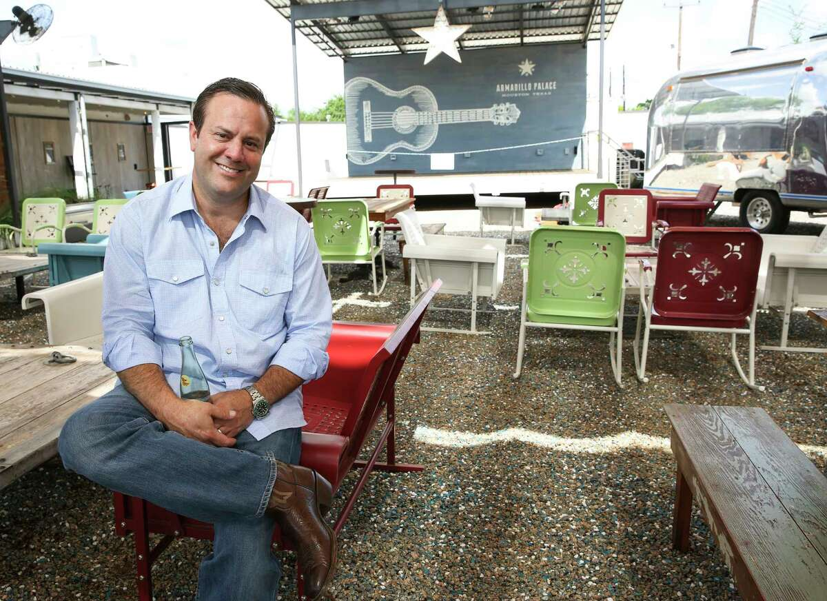 Levi Goode, owner of Goode Company restaurants, on the patio of Armadillo Palace.