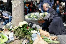 PARIS, FRANCE - APRIL 21:  Members of the Muslim community lay flowers following the shooting of a police officer being shot yesterday on the Champs Elysees on April 21 2017 in Paris, France. One police officer was killed and another wounded in a shooting on Paris's Champs Elysees, police said just days ahead of France's presidential election. France's interior ministry said the attacker was killed in the incident on the world famous boulevard that is popular with tourists. (Photo by Jeff J Mitchell/Getty Images)