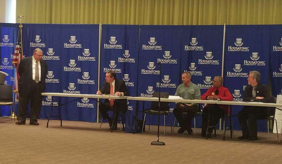 Former state Rep. Christopher Caruso, now a state Department of Labor employee, left, moderates a panel discussion hosted by the Southwest Connecticut Manufacturing Consortium featuring, from left, Nicholas Yanicelli, president of the Malta Justice Initiative, Mark Newton, a second chance member of Housatonic Community College's advanced manufacturing program, Adrienne Farrar Houel, president and CEO of the Greater Bridgeport Community Enterprises, and Dan Braccio, co-chair of the Bridgeport Re-entry Collaborative and Career Resources Inc. employee. Photo: Keila Torres Ocasio / Hearst Connecticut Media