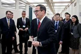 Steven Mnuchin, U.S. Treasury secretary, walks to hold a bilateral meeting with Xiao Jie, China's finance minister, not pictured, on the sidelines during the spring meetings of the International Monetary Fund (IMF) and World Bank in Washington, D.C., U.S., on Friday, April 21, 2017. Mnuchin sent U.S. stock prices to a daytime high Thursday when he said the Trump administration will produce an ambitious plan to overhaul the U.S. tax code soon. Photographer: Andrew Harrer/Bloomberg